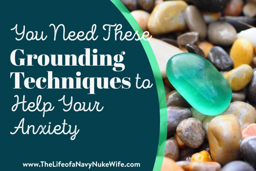 You Need These Grounding Techniques To Help Your Anxiety over rocks on beach and a beautiful sea glass
