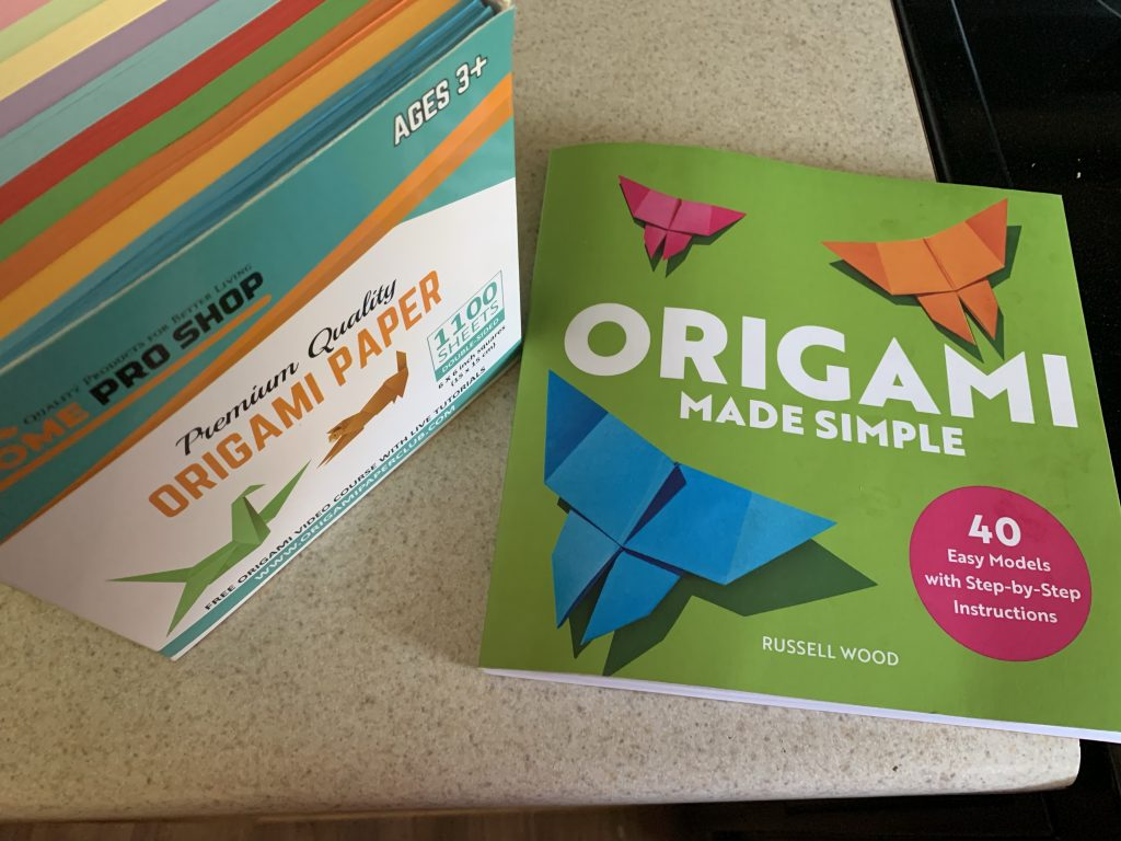 origami made simple book, next to a box of origami paper